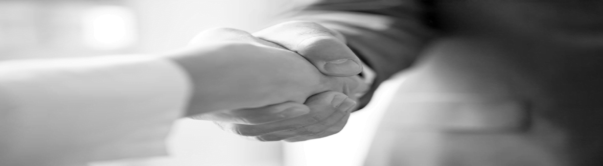 An attorney and client shaking hands after a mediation