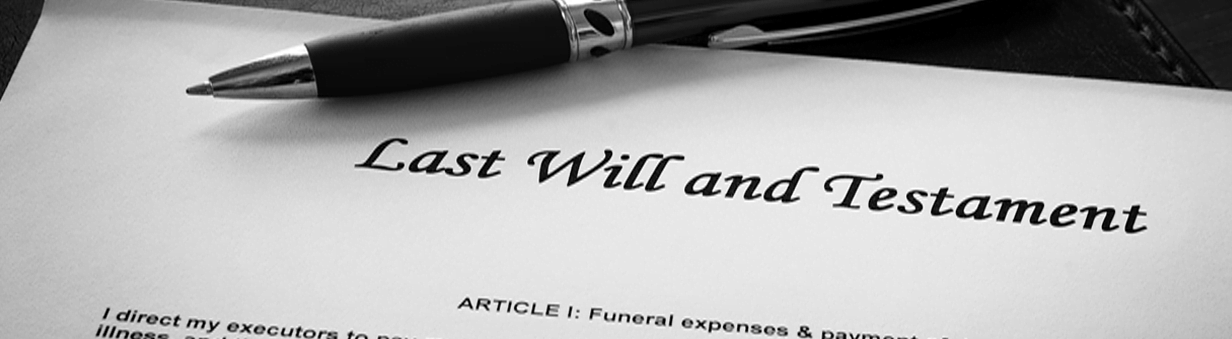 pen with a last will and testimate document